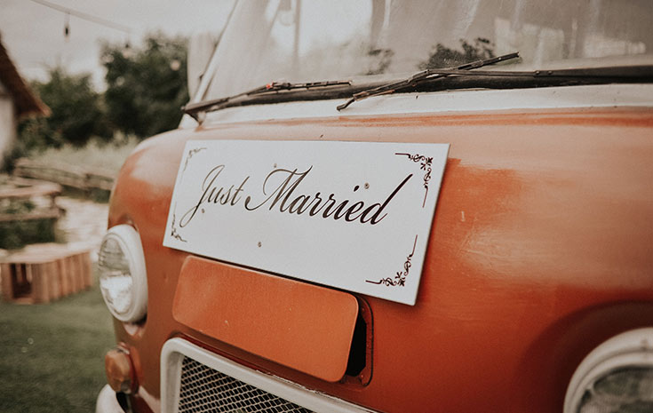Just married sign on orange van