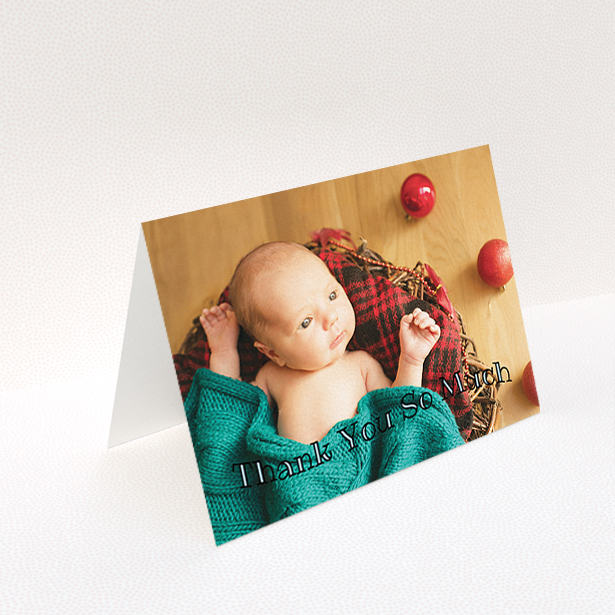 """A baby card design named """"Curvy Thanks"""". It is an A6 card in a landscape orientation. It is a photographic baby card with room for 1 photo. """"Curvy Thanks"""" is available as a folded card, with mainly blue colouring."""