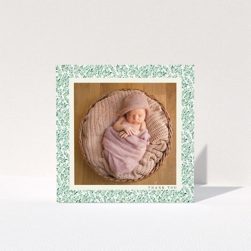 """A baby card design titled """"Hedgerow Frame"""". It is a square (148mm x 148mm) card in a square orientation. It is a photographic baby card with room for 1 photo. """"Hedgerow Frame"""" is available as a folded card, with tones of green and white."""