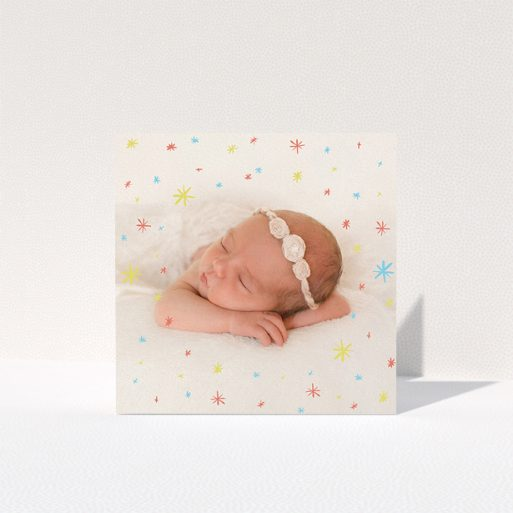 """A baby card design named """"Playground Sparkles"""". It is a square (148mm x 148mm) card in a square orientation. It is a photographic baby card with room for 1 photo. """"Playground Sparkles"""" is available as a folded card, with mainly red colouring."""