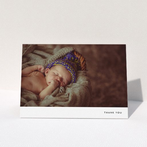"""A baby card design titled """"Thankful with Simplicity"""". It is an A5 card in a landscape orientation. It is a photographic baby card with room for 1 photo. """"Thankful with Simplicity"""" is available as a folded card, with mainly white colouring."""
