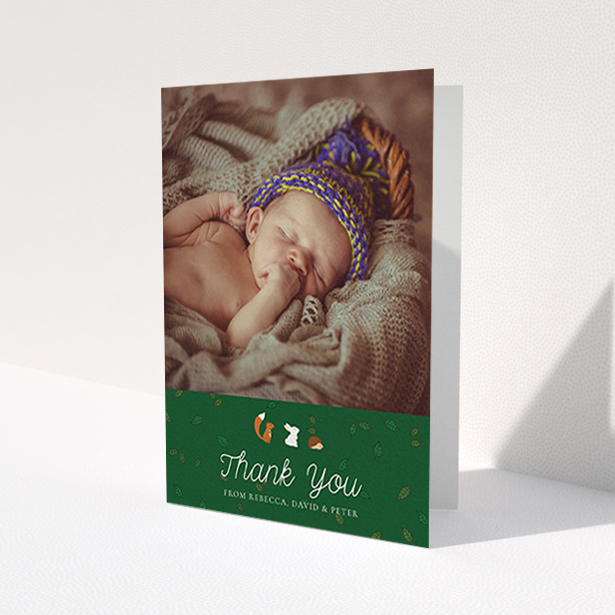 """A baby card design titled """"Woodland Chums"""". It is an A6 card in a portrait orientation. It is a photographic baby card with room for 1 photo. """"Woodland Chums"""" is available as a folded card, with tones of green, orange and brown."""