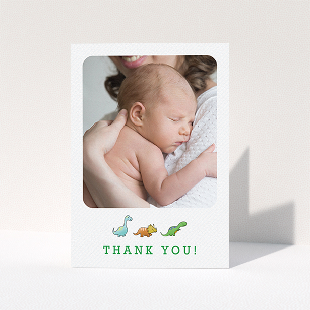 """A baby thank you card design called """"BabySaurus"""". It is an A6 card in a portrait orientation. It is a photographic baby thank you card with room for 1 photo. """"BabySaurus"""" is available as a folded card, with tones of white, green and light blue."""
