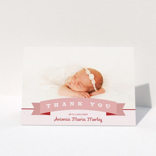 """A baby thank you card called """"Big Banner"""". It is an A5 card in a landscape orientation. It is a photographic baby thank you card with room for 1 photo. """"Big Banner"""" is available as a folded card, with tones of pink and white."""