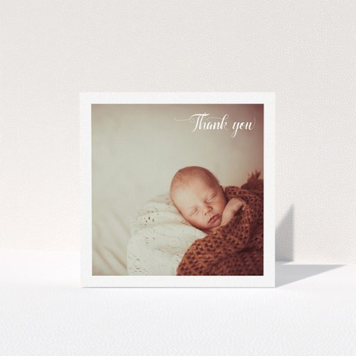 """A baby thank you card design called """"Central Square Frame"""". It is a square (148mm x 148mm) card in a square orientation. It is a photographic baby thank you card with room for 1 photo. """"Central Square Frame"""" is available as a folded card, with mainly white colouring."""