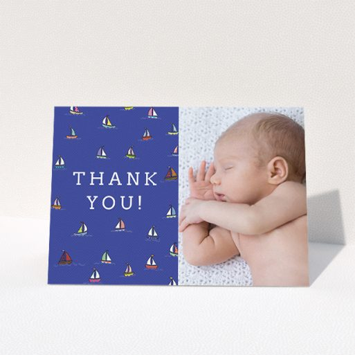 """A baby thank you card template titled """"Cowes Week"""". It is an A5 card in a landscape orientation. It is a photographic baby thank you card with room for 1 photo. """"Cowes Week"""" is available as a folded card, with mainly blue colouring."""