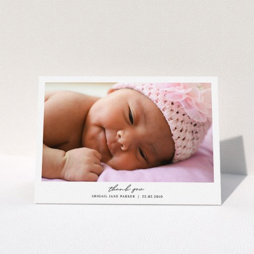 """A baby thank you card design named """"Everything You Need"""". It is an A5 card in a landscape orientation. It is a photographic baby thank you card with room for 1 photo. """"Everything You Need"""" is available as a folded card, with mainly white colouring."""