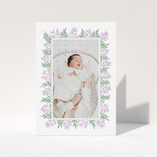"""A baby thank you card named """"Floral Frame"""". It is an A6 card in a portrait orientation. It is a photographic baby thank you card with room for 1 photo. """"Floral Frame"""" is available as a folded card, with tones of purple and green."""