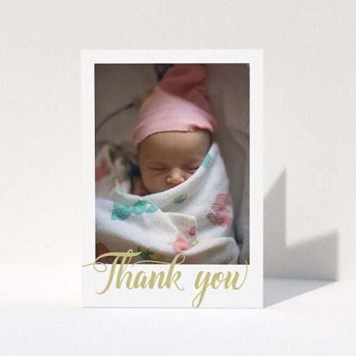 """A baby thank you card design called """"Golden Thank You"""". It is an A5 card in a portrait orientation. It is a photographic baby thank you card with room for 1 photo. """"Golden Thank You"""" is available as a folded card, with tones of white and gold."""