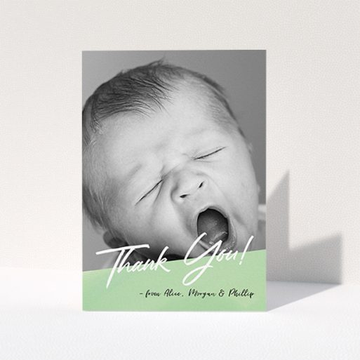 """A baby thank you card design titled """"Green Slant"""". It is an A6 card in a portrait orientation. It is a photographic baby thank you card with room for 1 photo. """"Green Slant"""" is available as a folded card, with mainly green colouring."""