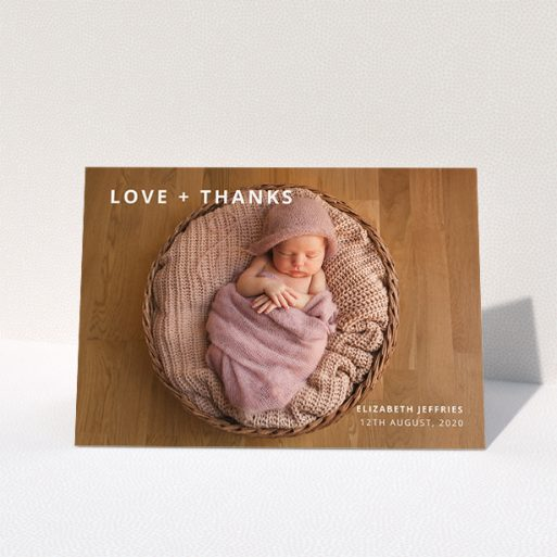 """A baby thank you card named """"Love and Thanks Landscape"""". It is an A5 card in a landscape orientation. It is a photographic baby thank you card with room for 1 photo. """"Love and Thanks Landscape"""" is available as a folded card, with mainly white colouring."""