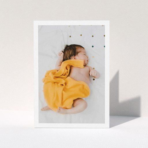 """A baby thank you card template titled """"One Photo Thanks"""". It is an A5 card in a portrait orientation. It is a photographic baby thank you card with room for 1 photo. """"One Photo Thanks"""" is available as a folded card, with mainly white colouring."""