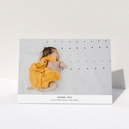 """A baby thank you card design named """"Sans Serif"""". It is an A5 card in a landscape orientation. It is a photographic baby thank you card with room for 1 photo. """"Sans Serif"""" is available as a folded card, with mainly white colouring."""