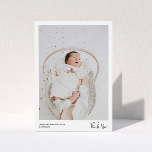 """A baby thank you card design called """"Simple Wedding Thank You"""". It is an A5 card in a portrait orientation. It is a photographic baby thank you card with room for 1 photo. """"Simple Wedding Thank You"""" is available as a folded card, with mainly white colouring."""