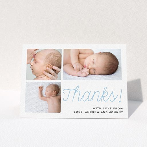 """A baby thank you card called """"Thank You Cursive"""". It is an A6 card in a landscape orientation. It is a photographic baby thank you card with room for 3 photos. """"Thank You Cursive"""" is available as a folded card, with tones of white and blue."""
