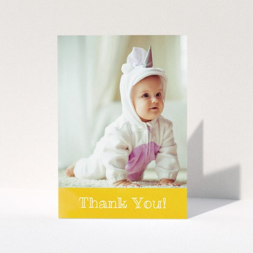"""A baby thank you card design called """"Thanks In Yellow"""". It is an A5 card in a portrait orientation. It is a photographic baby thank you card with room for 1 photo. """"Thanks In Yellow"""" is available as a folded card, with tones of yellow and white."""