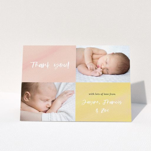 """A baby thank you card design titled """"Watercolour Corners"""". It is an A6 card in a landscape orientation. It is a photographic baby thank you card with room for 2 photos. """"Watercolour Corners"""" is available as a folded card, with tones of yellow and purple."""
