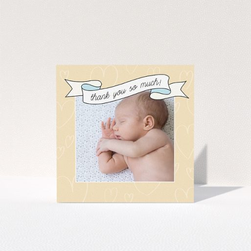"""A baby thank you card called """"Written Above"""". It is a square (148mm x 148mm) card in a square orientation. It is a photographic baby thank you card with room for 1 photo. """"Written Above"""" is available as a folded card, with tones of faded yellow and light blue."""