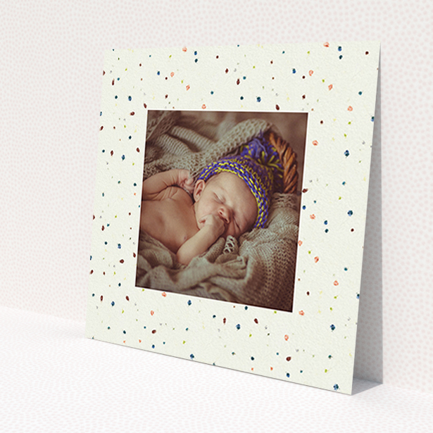 """A baptism invitation named """"Dot-dot-dot"""". It is a square (148mm x 148mm) invite card in a square orientation. It is a photographic baptism invitation with room for 1 photo. """"Dot-dot-dot"""" is available as a flat invite card, with mainly cream colouring."""