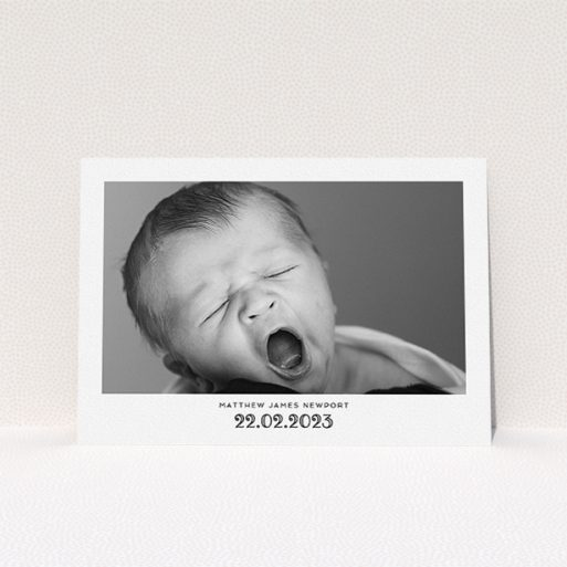 """A baptism invitation called """"Ornate Date"""". It is an A5 invite card in a landscape orientation. It is a photographic baptism invitation with room for 1 photo. """"Ornate Date"""" is available as a flat invite card, with mainly white colouring."""
