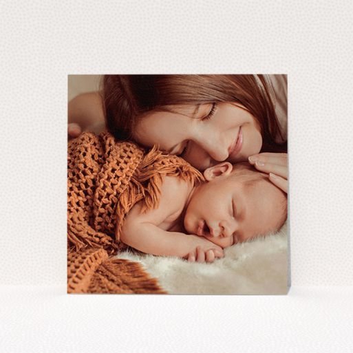 """A baptism invitation design called """"Our New Arrival"""". It is a square (148mm x 148mm) invite card in a square orientation. It is a photographic baptism invitation with room for 1 photo. """"Our New Arrival"""" is available as a flat invite card, with mainly white colouring."""