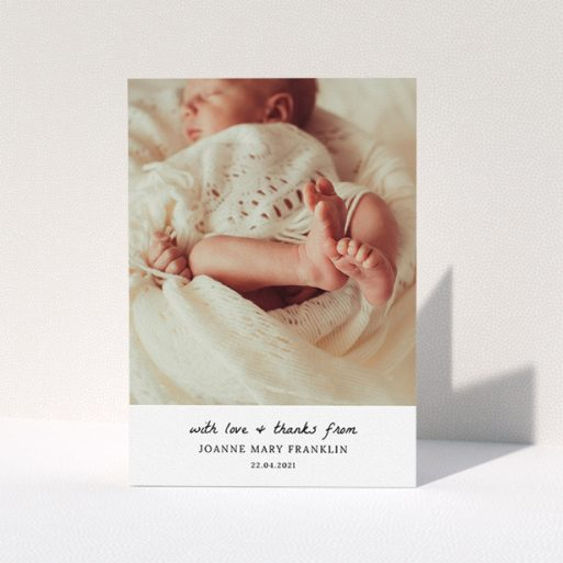 """A baptism thank you card design named """"Black and White Thanks"""". It is an A5 card in a portrait orientation. It is a photographic baptism thank you card with room for 1 photo. """"Black and White Thanks"""" is available as a folded card, with mainly white colouring."""