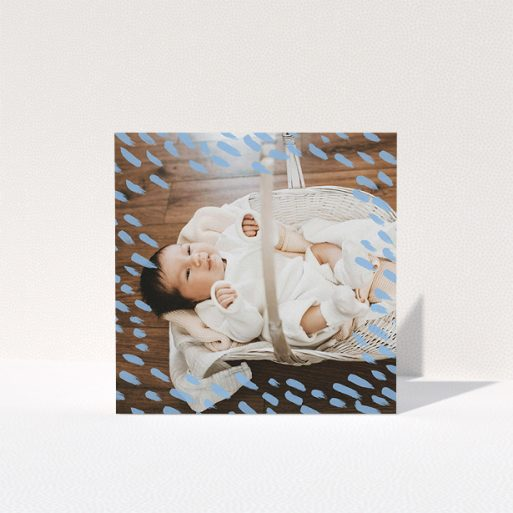 """A baptism thank you card design called """"Blue Daubs"""". It is a square (148mm x 148mm) card in a square orientation. It is a photographic baptism thank you card with room for 1 photo. """"Blue Daubs"""" is available as a folded card, with mainly blue colouring."""
