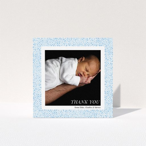 """A baptism thank you card template titled """"Blue Floral Frame"""". It is a square (148mm x 148mm) card in a square orientation. It is a photographic baptism thank you card with room for 1 photo. """"Blue Floral Frame"""" is available as a folded card, with tones of blue and white."""