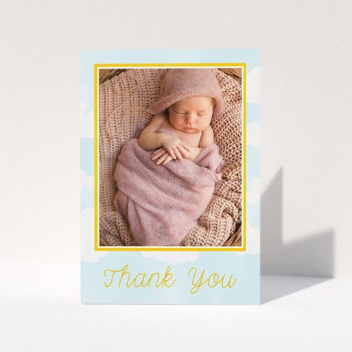 """A baptism thank you card design called """"Blue Skies"""". It is an A6 card in a portrait orientation. It is a photographic baptism thank you card with room for 1 photo. """"Blue Skies"""" is available as a folded card, with tones of blue, yellow and white."""