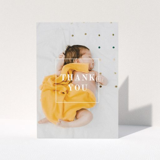 """A baptism thank you card design named """"Central Thanks"""". It is an A5 card in a portrait orientation. It is a photographic baptism thank you card with room for 1 photo. """"Central Thanks"""" is available as a folded card, with mainly white colouring."""