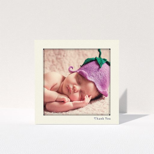 """A baptism thank you card named """"Cream Deco"""". It is a square (148mm x 148mm) card in a square orientation. It is a photographic baptism thank you card with room for 1 photo. """"Cream Deco"""" is available as a folded card, with mainly cream colouring."""