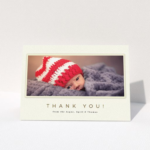 """A baptism thank you card design named """"Torn Cream Frame"""". It is an A6 card in a landscape orientation. It is a photographic baptism thank you card with room for 1 photo. """"Torn Cream Frame"""" is available as a folded card, with mainly cream colouring."""
