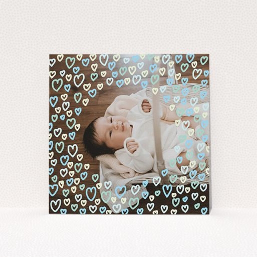 """A birth announcement card design called """"Blue Hearts"""". It is a square (148mm x 148mm) card in a square orientation. It is a photographic birth announcement card with room for 1 photo. """"Blue Hearts"""" is available as a flat card, with mainly blue colouring."""
