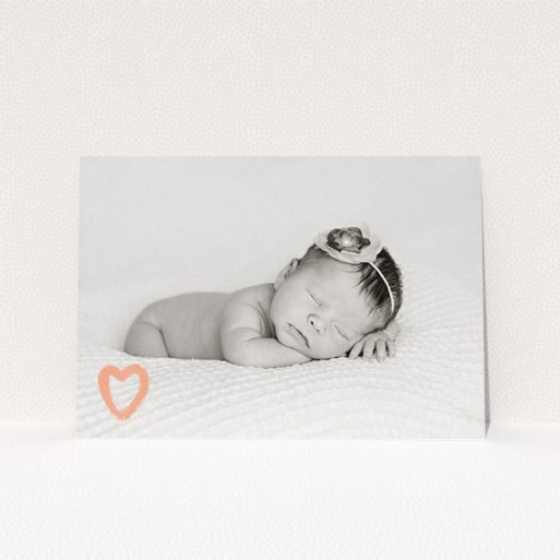 """A birth announcement card design called """"Pastel Heart"""". It is an A5 card in a landscape orientation. It is a photographic birth announcement card with room for 1 photo. """"Pastel Heart"""" is available as a flat card, with mainly peach colouring."""