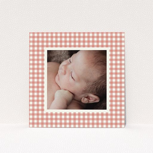 """A birth announcement card design titled """"Pink Plaid"""". It is a square (148mm x 148mm) card in a square orientation. It is a photographic birth announcement card with room for 1 photo. """"Pink Plaid"""" is available as a flat card, with tones of pink and white."""