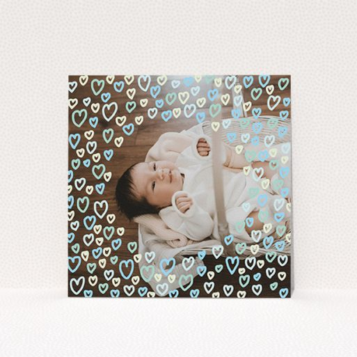"""A christening invitation design titled """"Blue Hearts"""". It is a square (148mm x 148mm) invite in a square orientation. It is a photographic christening invitation with room for 1 photo. """"Blue Hearts"""" is available as a flat invite, with mainly blue colouring."""