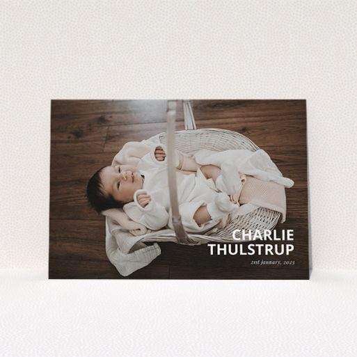 """A christening invitation named """"Bold Corner Photo"""". It is an A5 invite in a landscape orientation. It is a photographic christening invitation with room for 1 photo. """"Bold Corner Photo"""" is available as a flat invite, with mainly white colouring."""