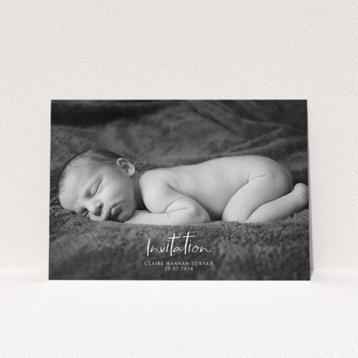 """A christening invitation template titled """"Central Script"""". It is an A5 invite in a landscape orientation. It is a photographic christening invitation with room for 1 photo. """"Central Script"""" is available as a flat invite, with mainly white colouring."""