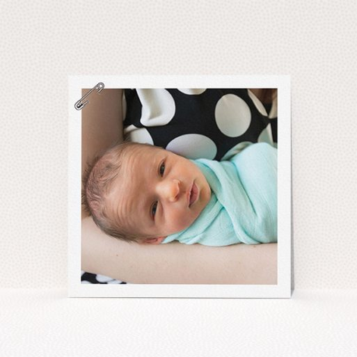 """A christening invitation design called """"Put a pin in it"""". It is a square (148mm x 148mm) invite in a square orientation. It is a photographic christening invitation with room for 1 photo. """"Put a pin in it"""" is available as a flat invite, with mainly white colouring."""