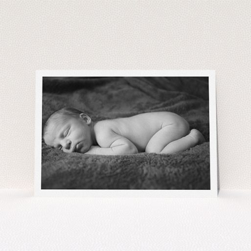 """A christening invitation named """"Thick White Framed Photo"""". It is an A5 invite in a landscape orientation. It is a photographic christening invitation with room for 1 photo. """"Thick White Framed Photo"""" is available as a flat invite, with mainly white colouring."""