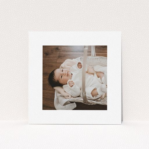 """A christening invitation named """"We have some news"""". It is a square (148mm x 148mm) invite in a square orientation. It is a photographic christening invitation with room for 1 photo. """"We have some news"""" is available as a flat invite, with mainly white colouring."""