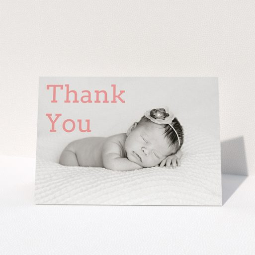 """A christening thank you card design called """"Big Thanks"""". It is an A5 card in a landscape orientation. It is a photographic christening thank you card with room for 1 photo. """"Big Thanks"""" is available as a folded card, with mainly light pink colouring."""