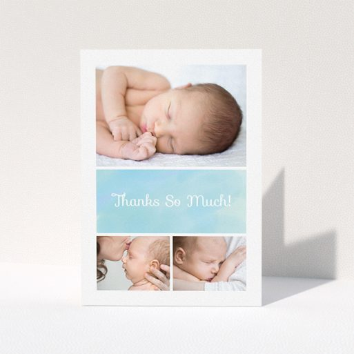 """A christening thank you card called """"Block Tower"""". It is an A5 card in a portrait orientation. It is a photographic christening thank you card with room for 3 photos. """"Block Tower"""" is available as a folded card, with tones of blue and white."""