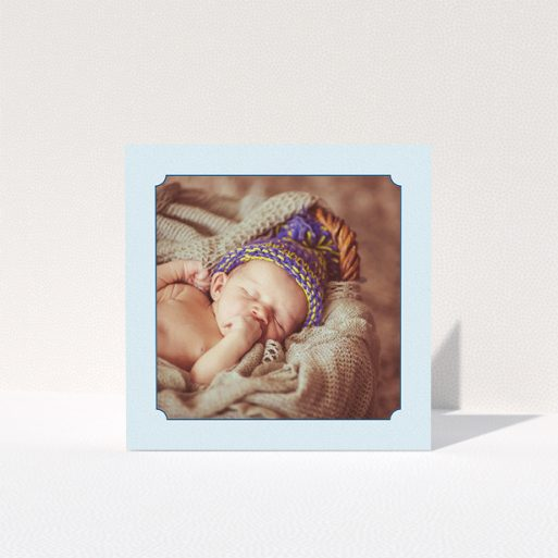 """A christening thank you card design called """"Classic Frame"""". It is a square (148mm x 148mm) card in a square orientation. It is a photographic christening thank you card with room for 1 photo. """"Classic Frame"""" is available as a folded card, with mainly blue colouring."""