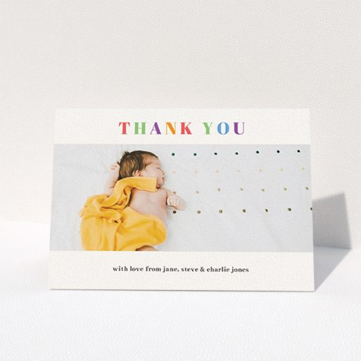 """A christening thank you card design titled """"Colourful Thanks"""". It is an A6 card in a landscape orientation. It is a photographic christening thank you card with room for 1 photo. """"Colourful Thanks"""" is available as a folded card, with tones of white and orange."""