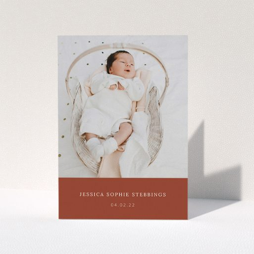 """A christening thank you card design named """"Dark Ochre Footer"""". It is an A5 card in a portrait orientation. It is a photographic christening thank you card with room for 1 photo. """"Dark Ochre Footer"""" is available as a folded card, with mainly dark orange colouring."""