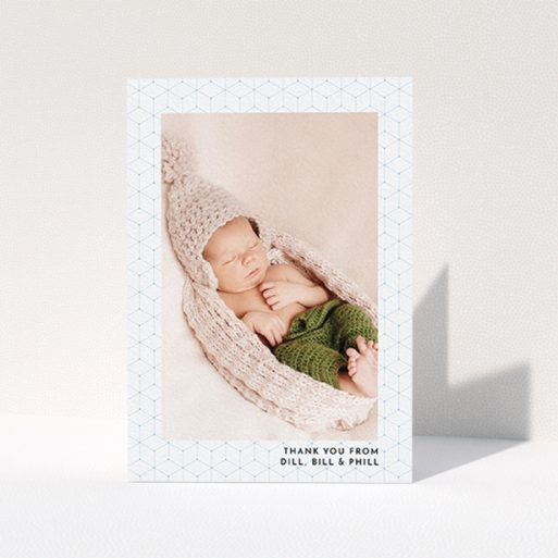 """A christening thank you card called """"Isometric Frame"""". It is an A6 card in a portrait orientation. It is a photographic christening thank you card with room for 1 photo. """"Isometric Frame"""" is available as a folded card, with mainly blue colouring."""