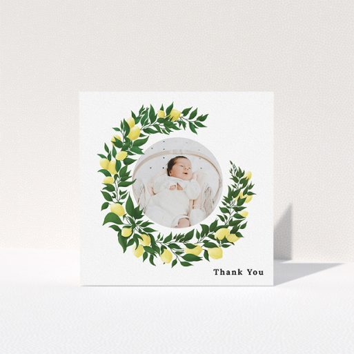 """A christening thank you card called """"Lemon Wreath"""". It is a square (148mm x 148mm) card in a square orientation. It is a photographic christening thank you card with room for 1 photo. """"Lemon Wreath"""" is available as a folded card, with tones of green and yellow."""