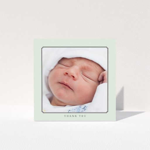 """A christening thank you card design titled """"Mint Deco"""". It is a square (148mm x 148mm) card in a square orientation. It is a photographic christening thank you card with room for 1 photo. """"Mint Deco"""" is available as a folded card, with tones of green and white."""