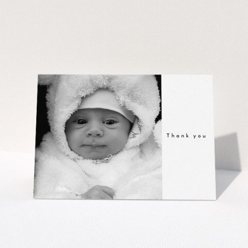 """A christening thank you card design named """"Most of the Page Frame"""". It is an A5 card in a landscape orientation. It is a photographic christening thank you card with room for 1 photo. """"Most of the Page Frame"""" is available as a folded card, with mainly white colouring."""
